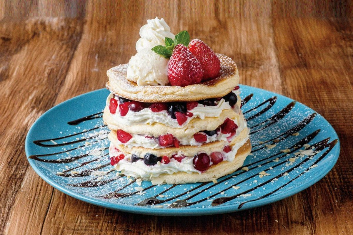 Strawberry and mixed berry pancakes at Osaka's belle-ville Pancake Cafe, which opened in Bugis Junction.