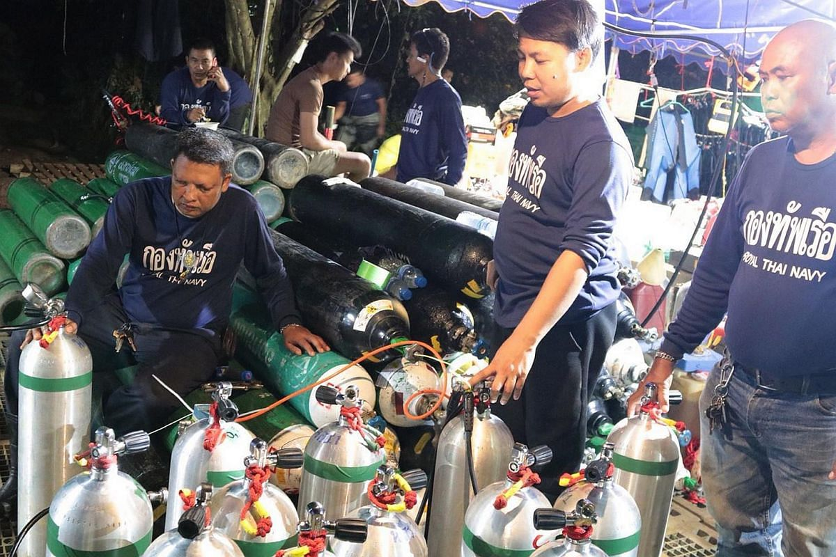 Thai Navy personnel filling up oxygen tanks for the rescue operation at Tham Luang cave on July 7, 2018.