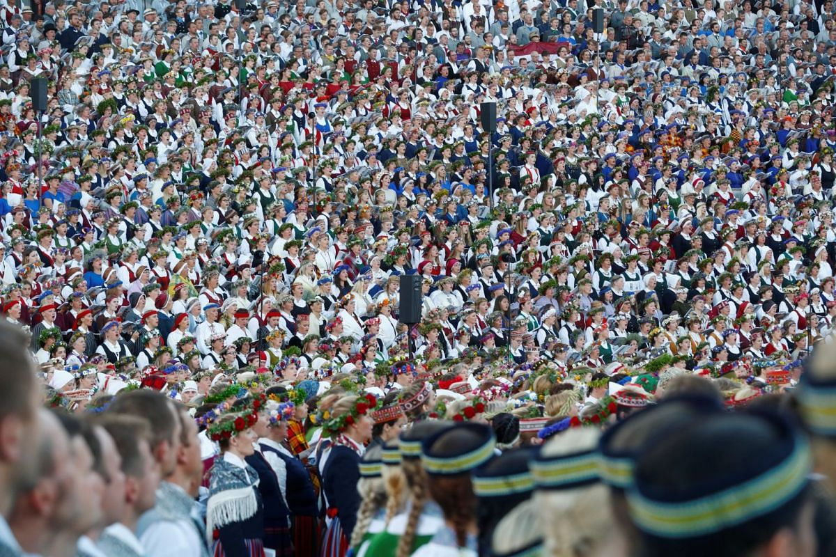 Choir performs during the final show at the Song and Dance Celebration in Riga, Latvia, July 8, 2018. Song and Dance Celebration is a nationwide traditional culture event that happens every five years. About 40,000 participants from 3,421 amateur cho
