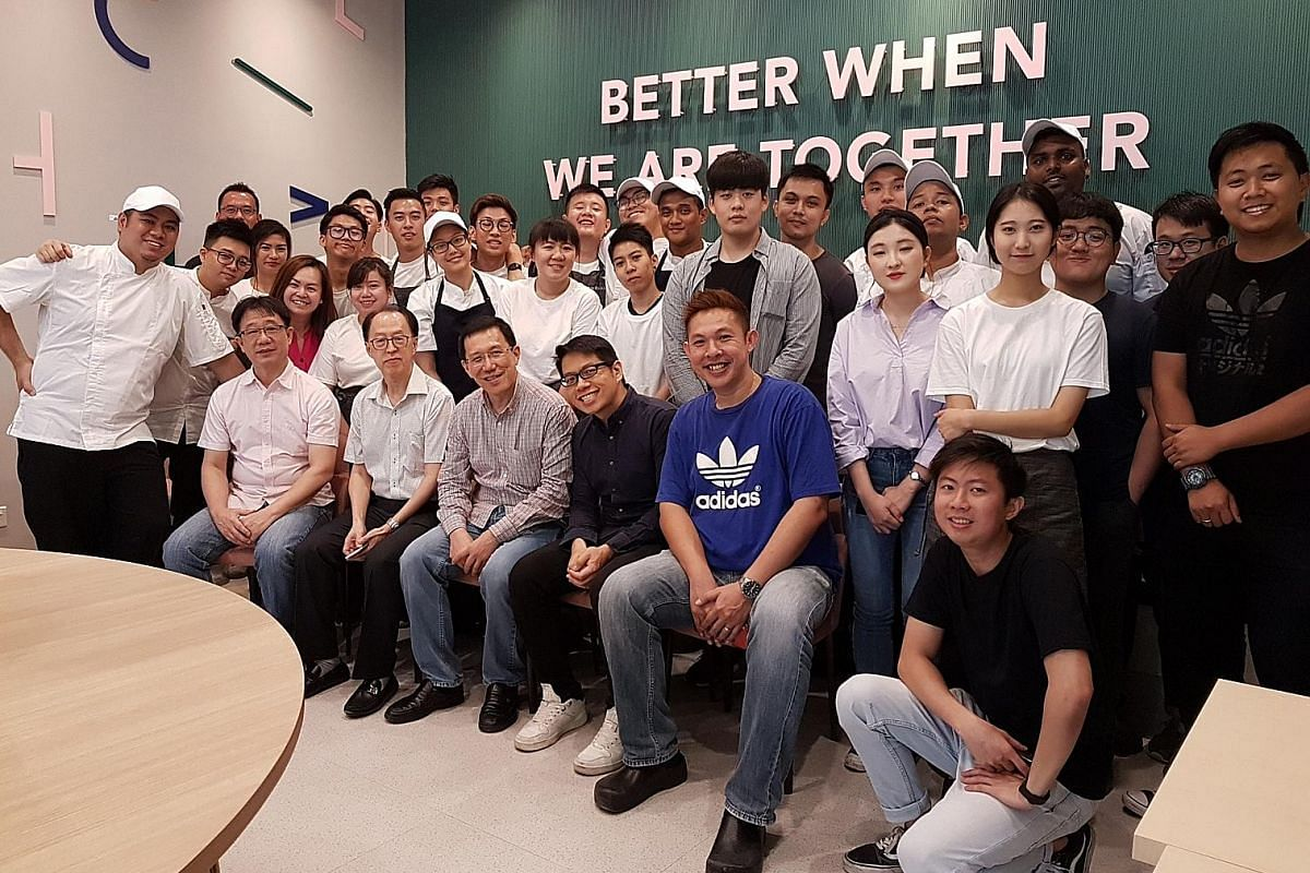 Seoul Garden Group chief executive Andrew Lee and his wife Linda (both centre) at the grand opening of Seoul Garden HotPot at Bedok Mall in August last year. The team of Seoul Garden Group's one-month-old concepts, Two Hana and Seoul In A Sandwich, w