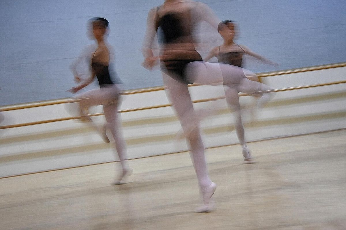Students are seen through the hallway of the Singapore Ballet Academy as they train during a youth group night class. The oldest ballet academy in Singapore was first housed in Kay Lee Road in 1958 and moved a few more times before settling in at Wat