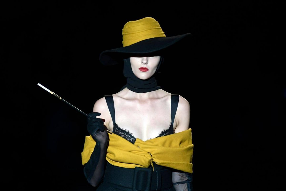 A model displays an outfit from Spanish designer Andres Sarda's Spring/Summer 2019 collection during Madrid's Mercedes Benz Fashion Week, on July 9, 2018.