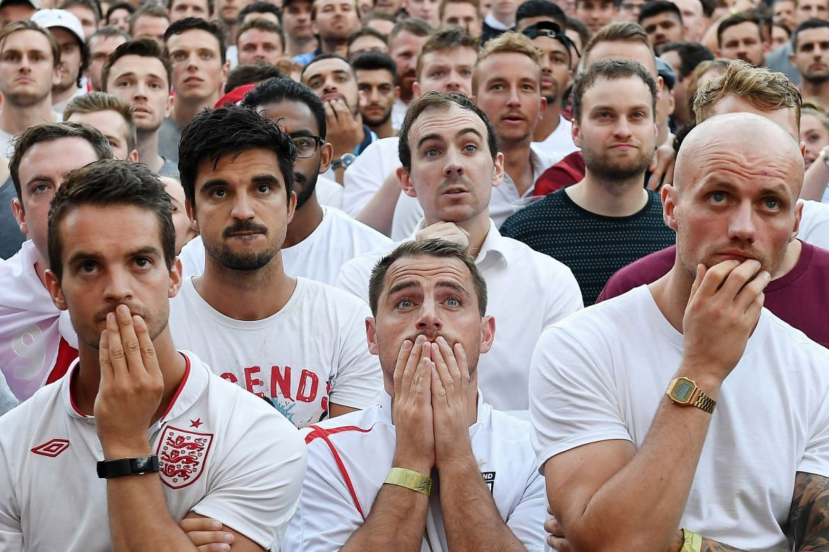 England fans watch the FIFA World Cup semi final between England and Croatia at a public viewing in London, Britain, July 11, 2018.