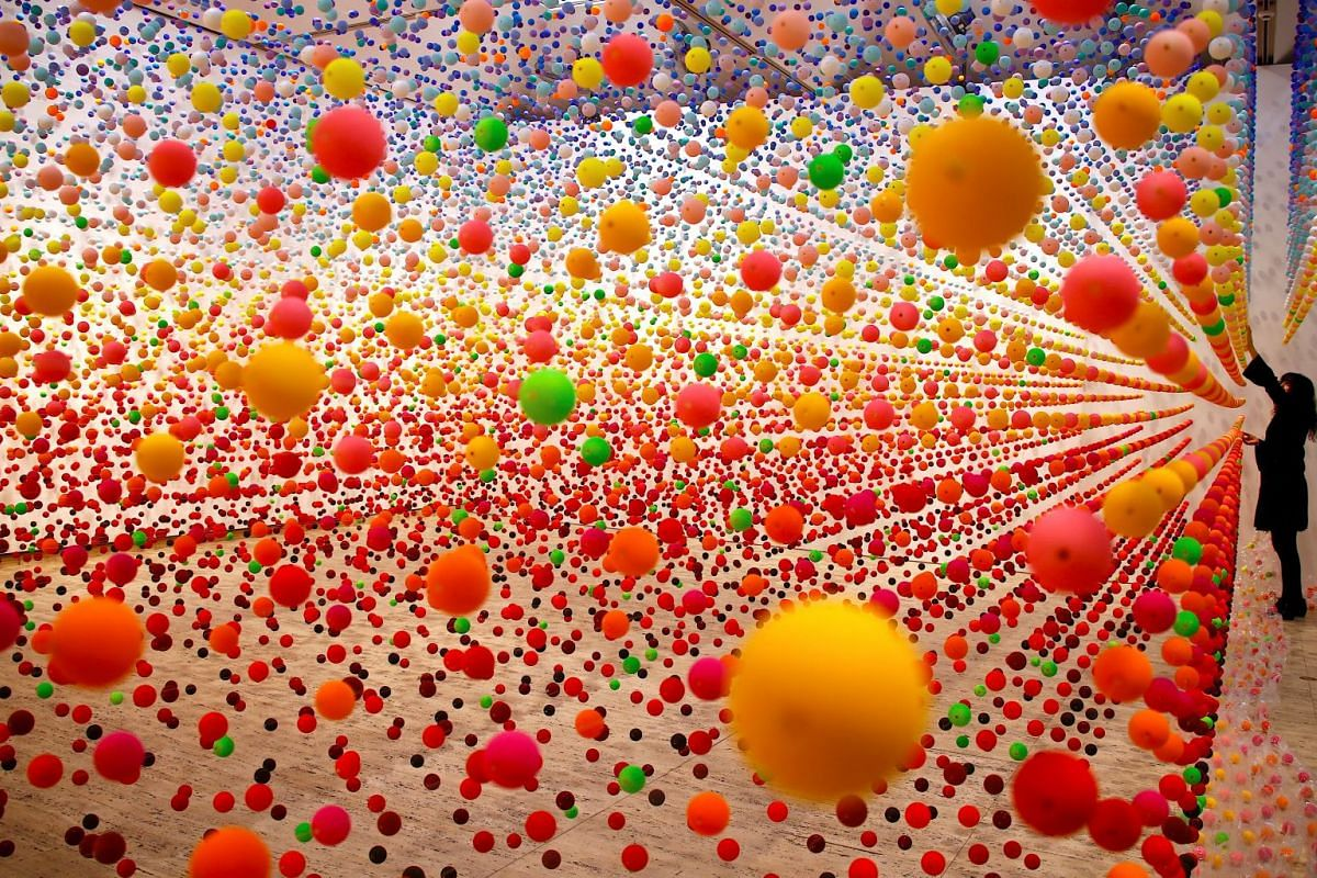 Australian artist Nike Savvas adjusts her installation artwork, consisting of over 50,000 polystyrene balls. Titled 'Atomic: full of love full of wonder', for the upcoming exhibition 'Spacemakers and roomshakers: installations from the collection' at