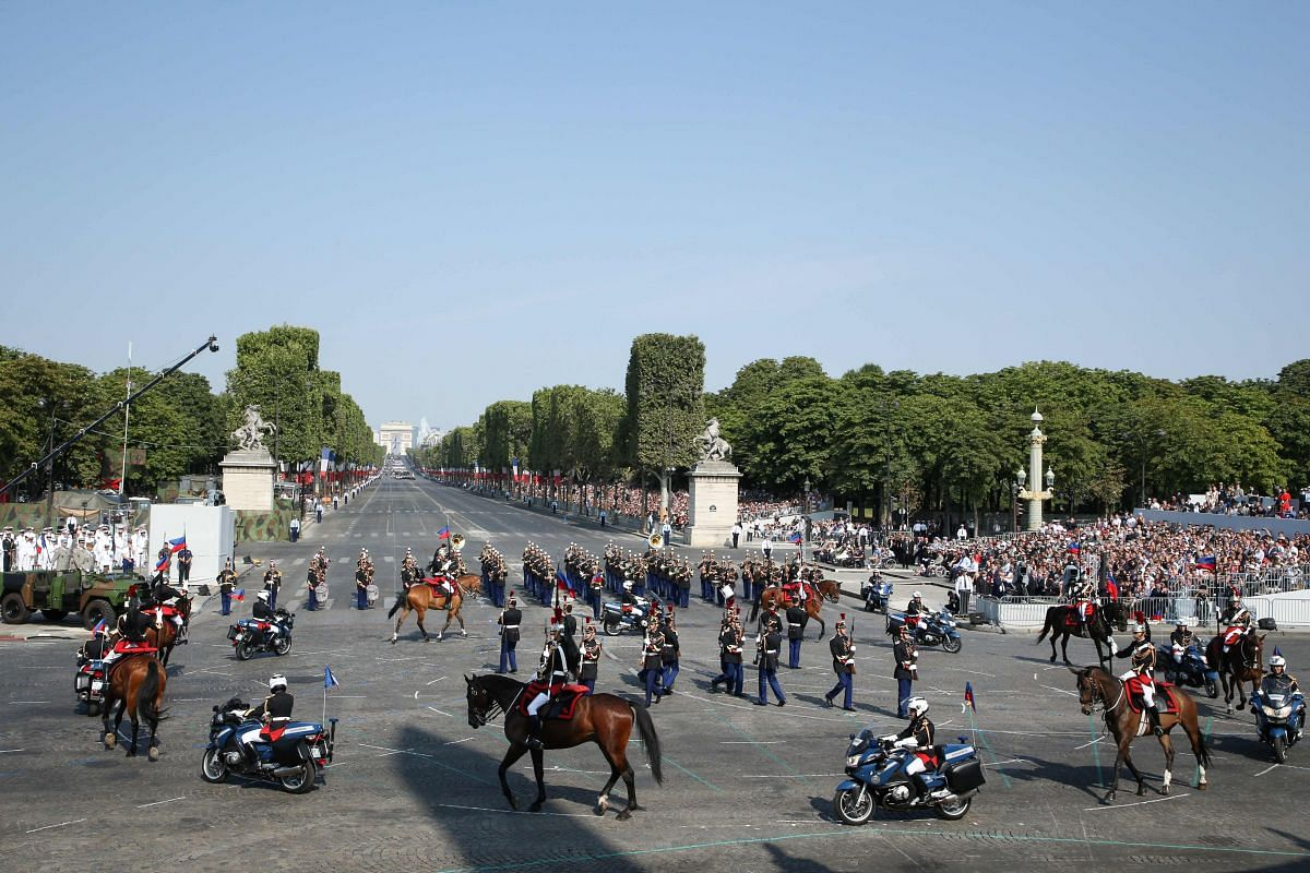 French Republican Guards perform at Place de la Concorde during Bastille Day celebrations in Paris on July 14, 2018.