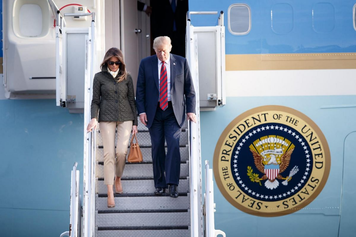 US President Donald Trump and US First Lady Melania Trump arrive at Prestwick Airport on July 13, 2018, ahead of a visit to the Trump Turnberry golf course in Ayrshire, Scotland.