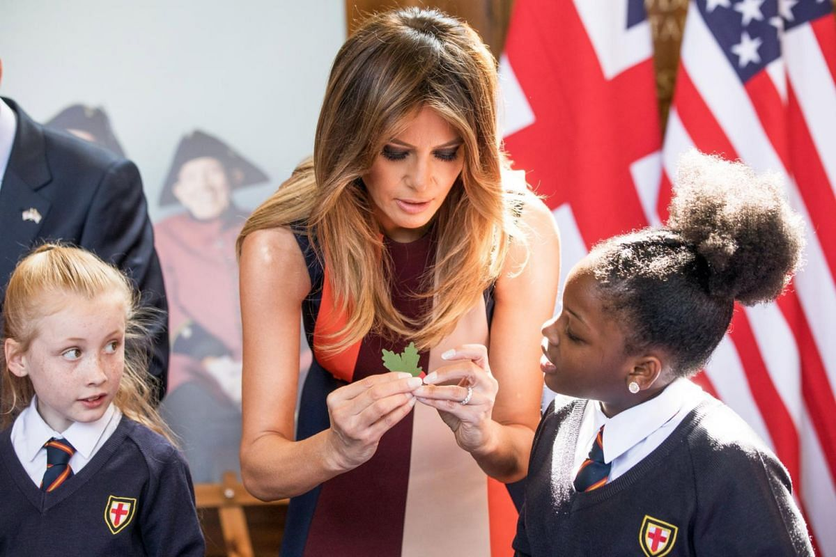 US First Lady Melania Trump helps schoolchildren make poppies during a visit to The Royal Hospital Chelsea in London on July 13, 2018.