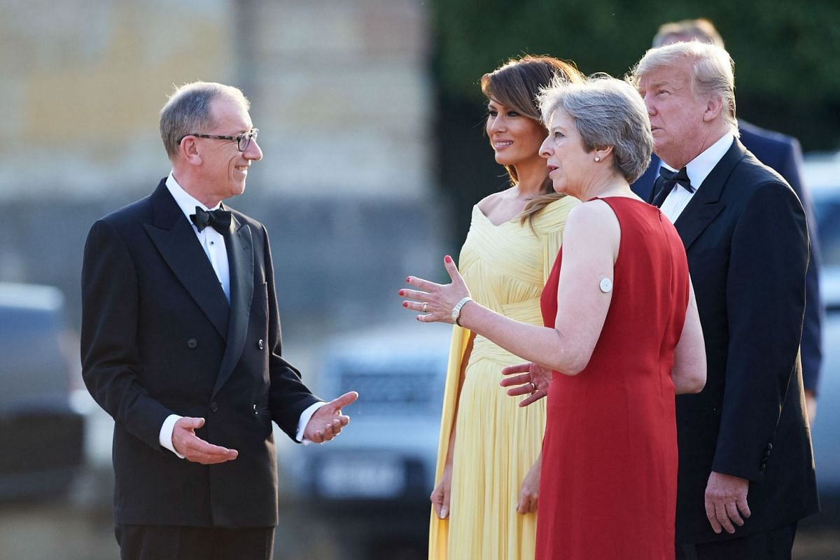 US President Donald Trump and US First Lady Melania Trump are welcomed by Britain's Prime Minister Theresa May and her husband Philip May as they arrive for a black-tie dinner with business leaders at Blenheim Palace on July 12, 2018.