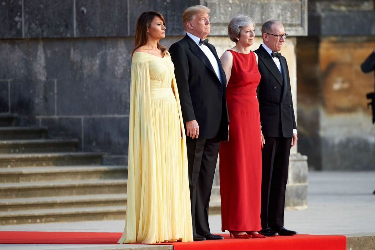US President Donald Trump, US First Lady Melania Trump, Britain's Prime Minister Theresa May and her husband Philip May watch a ceremonial welcome performance as they arrive for a black-tie dinner with business leaders at Blenheim Palace on July 12,