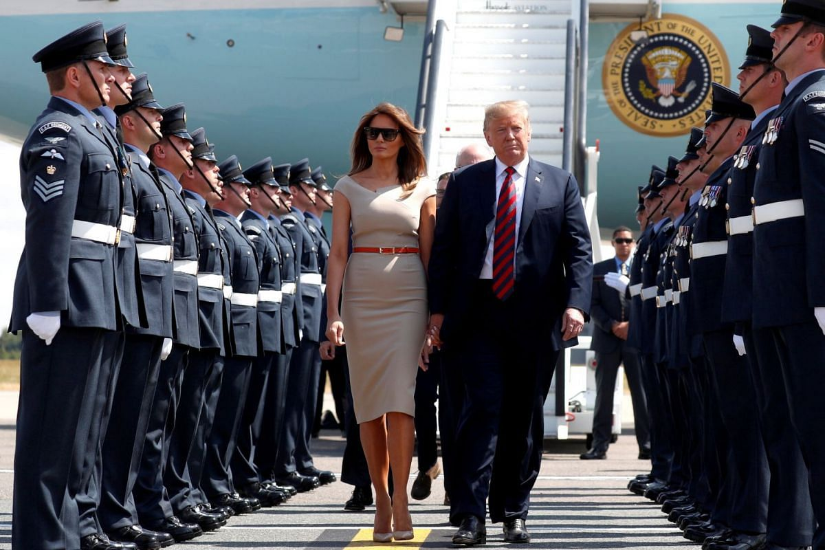 US President Donald Trump and US First Lady Melania Trump arrive at Britain's Stansted Airport on July 12, 2018.