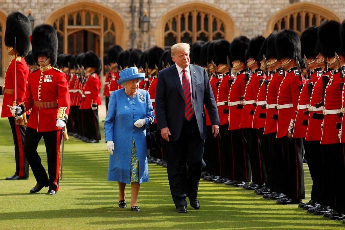 US President Donald Trump and Britain's Queen Elizabeth inspect the Coldstream Guards during a visit to Windsor Castle on July 13, 2018.