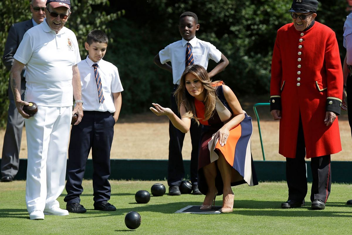 US First Lady Melania Trump plays bowls during a visit to the Royal Chelsea Hospital in London on July 13, 2018.