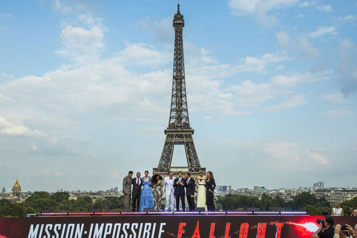 Cast and crew of Mission: Impossible - Fallout posing for a picture in front of the Eiffel Tower on July 12, 2018.