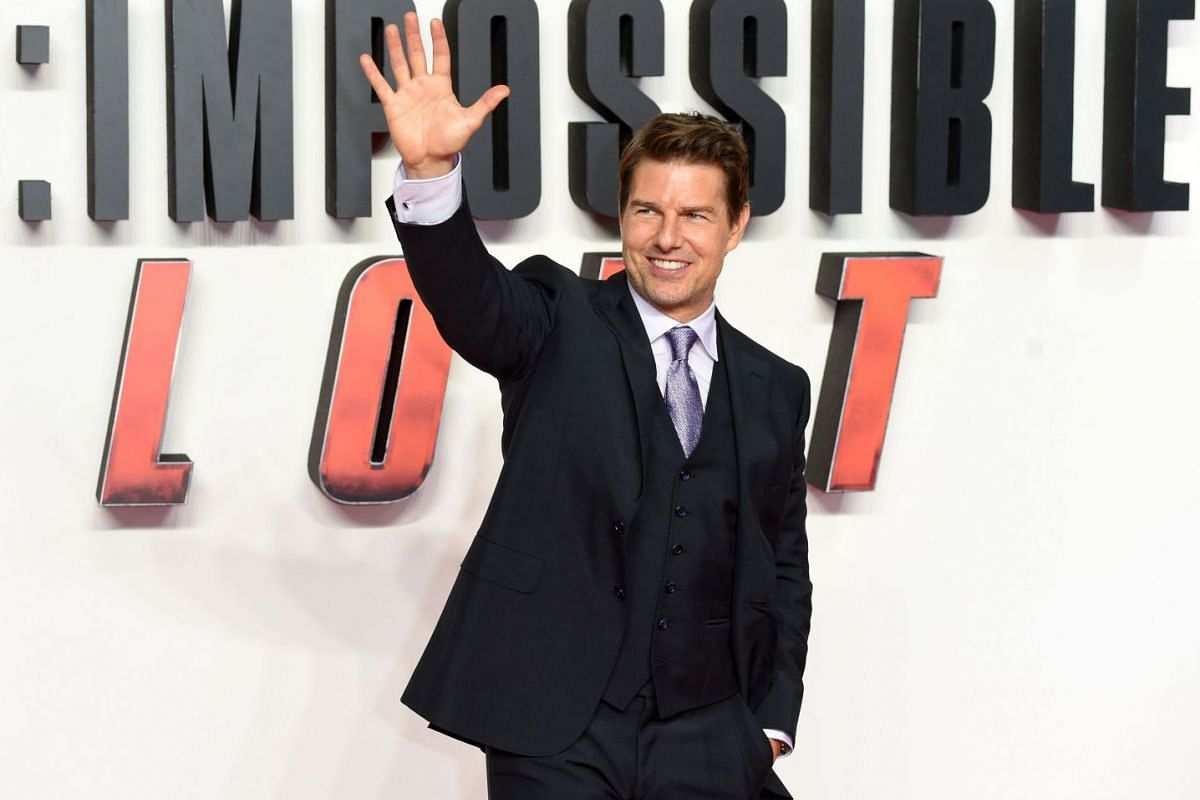 Actor Tom Cruise waving to the fans at the premiere of Mission: Impossible - Fallout in London on July 13, 2018.