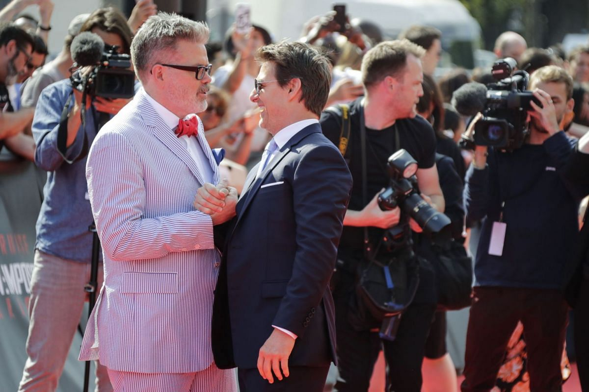 Actor Tom Cruise and producer Christopher McQuarrie greeting each other on the red carpet before the premiere of Mission: Impossible - Fallout in Paris on July 12, 2018.