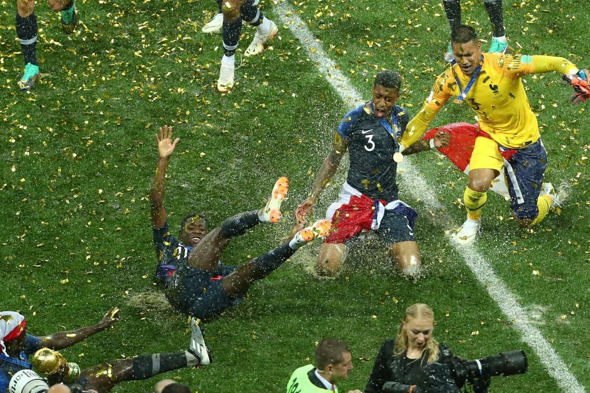 France's Ousmane Dembele, Presnel Kimpembe and Alphonse Areola celebrate winning 2018 Fifa World Cup, on July 15, 2018.