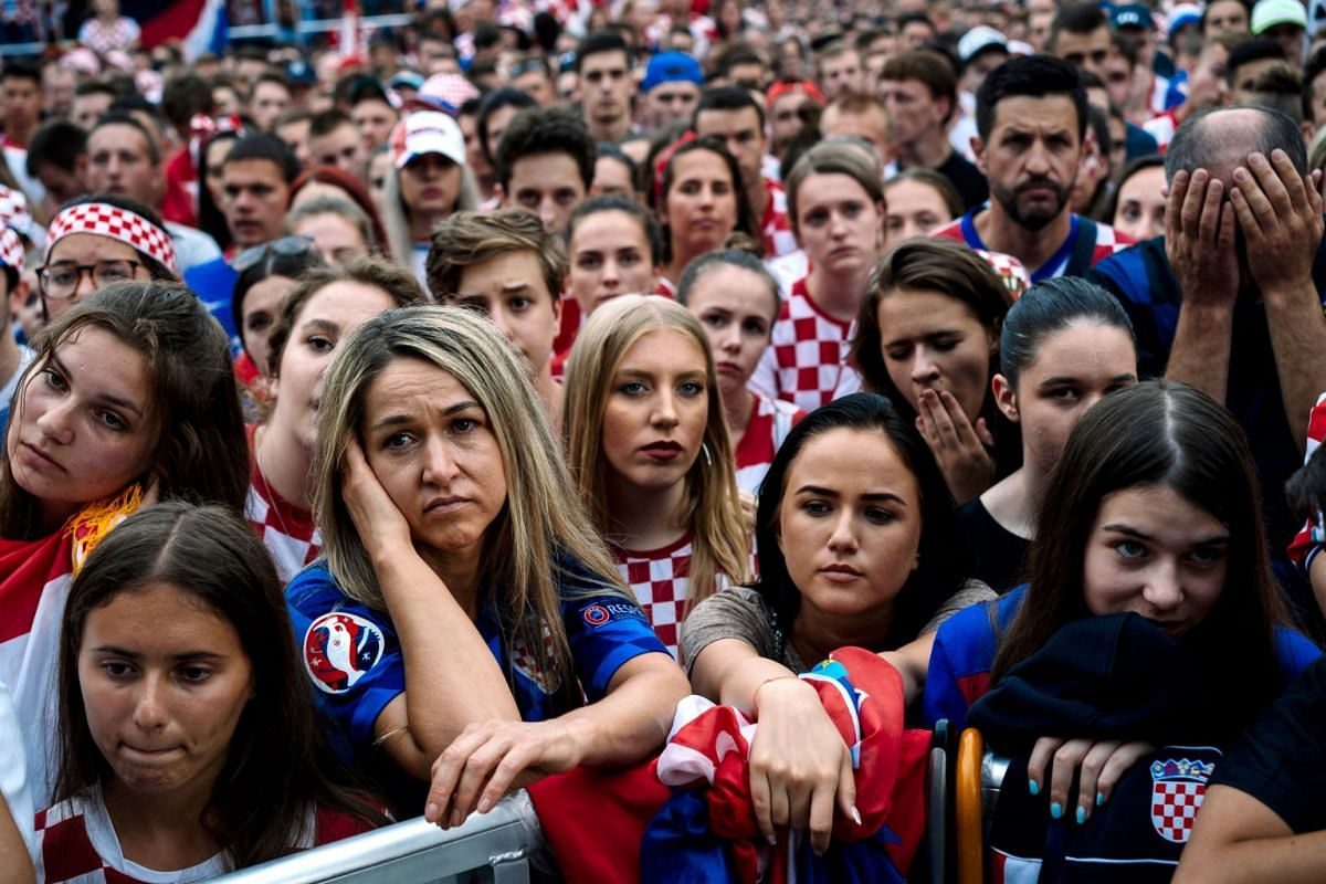 Croatian supporters reacting in dismay after the 2018 Russia World Cup final football match between Croatia and France, the first final World Cup match ever in the history of Croatia.