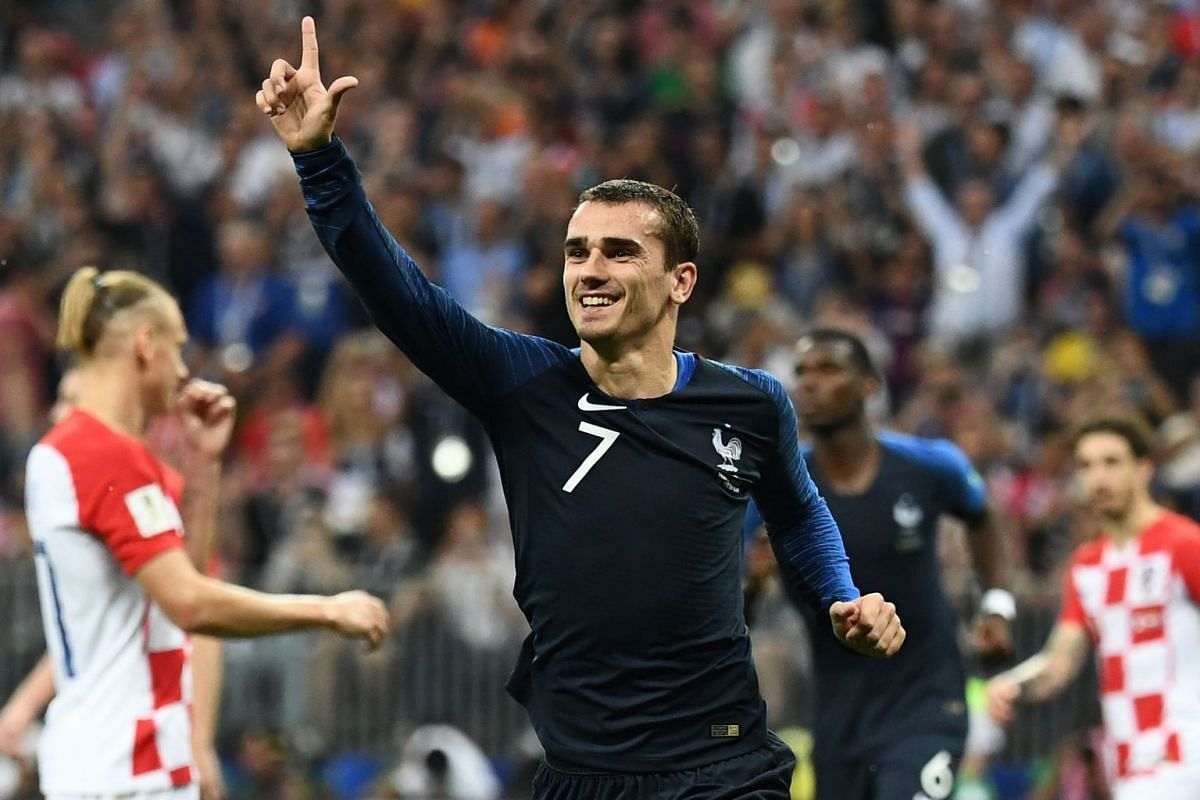 France's forward Antoine Griezmann celebrating after shooting a penalty kick to score his team's second goal during their Russia 2018 World Cup final football match between France and Croatia at the Luzhniki Stadium in Moscow, on July 15, 2018.