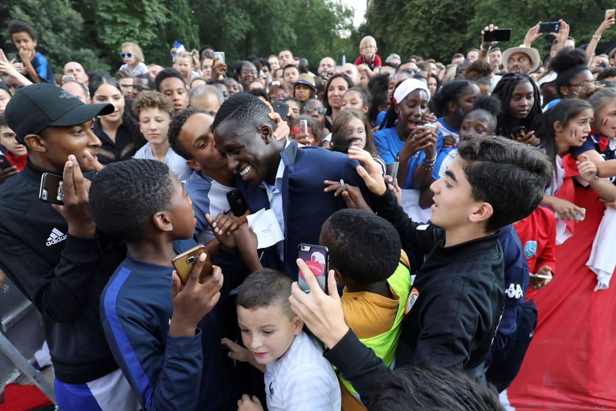 France's defender Benjamin Mendy is congratulated by supporters during a reception at the Elysee Presidential Palace after they won the Russia 2018 World Cup final football match, in Paris, France July 16, 2018. PHOTO: POOL VIA REUTERS