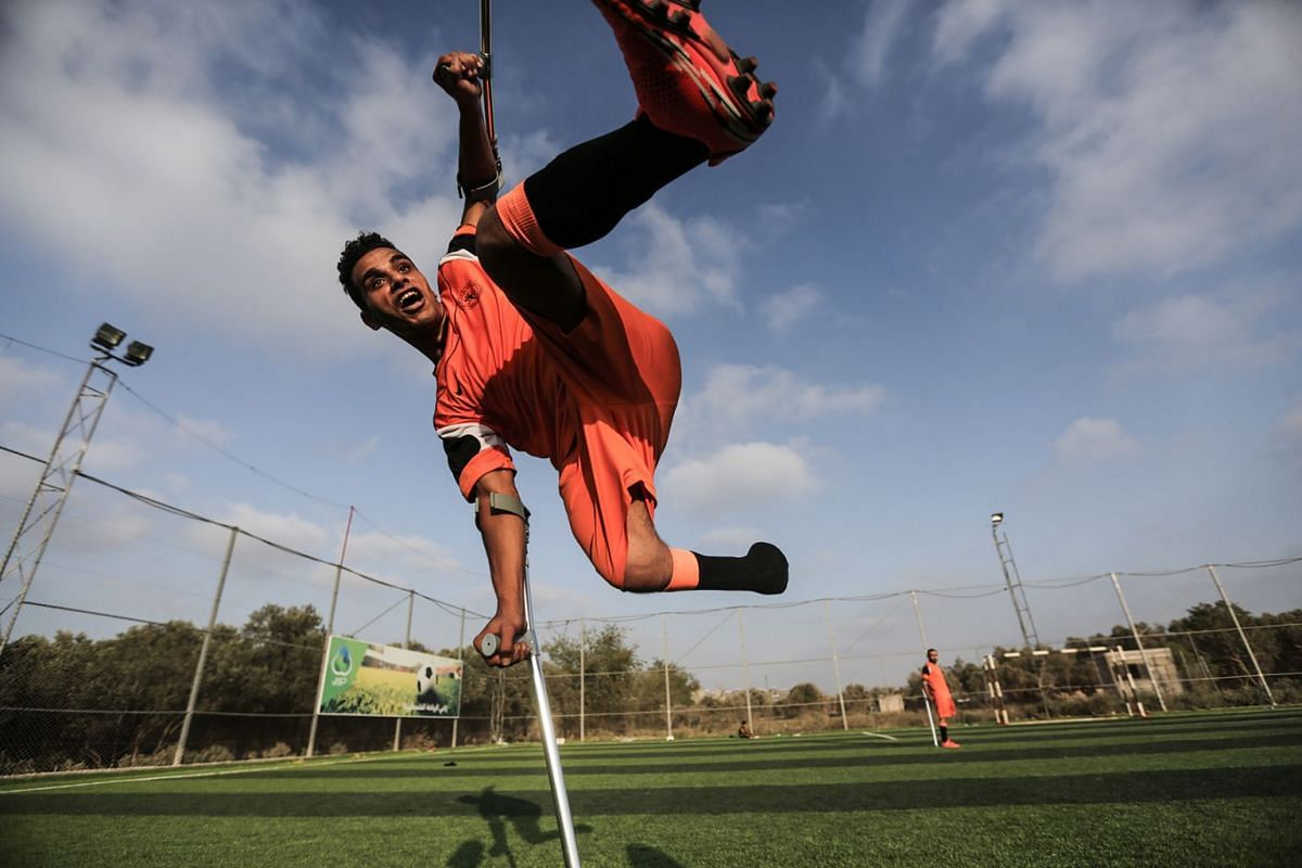 Palestinian amputee soccer players take part in a training session with their team in Deir Al Balah stadium in the central Gaza Strip, 16 July 2018. PHOTO: EPA-EFE