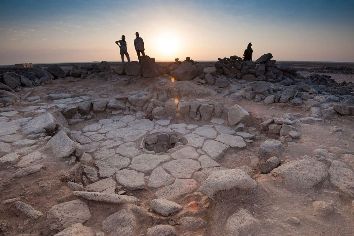 A stone structure at an archeological site containing a fireplace, seen in the middle, where charred remains of 14,500-year-old bread was found in the Black Desert, in northeastern Jordan in this photo provided July 16, 2018. PHOTO: HANDOUT VIA REUTE