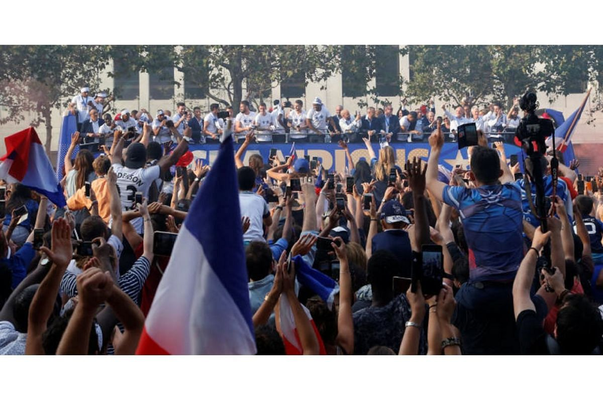 Fans cheer the French football team at the Champs-Elysee avenue in Paris, on July 16, 2018