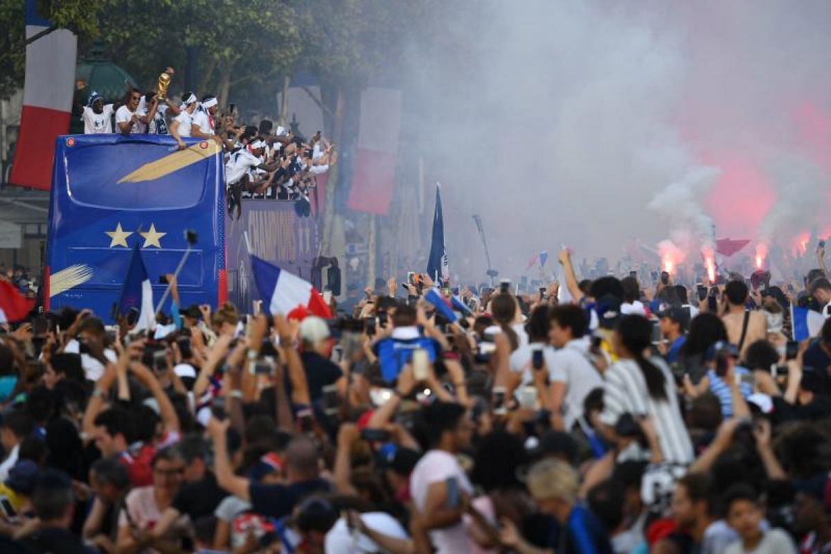 The French national football team celebrates with the trophy and greets their fans while parading down the Champs-Elysee avenue in Paris, on July 16, 2018.