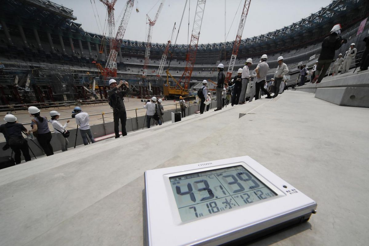 A thermometer shows the temperature and humidity at the construction site of the main stadium for the 2020 Olympic Games in Tokyo, Japan, on July 18, 2018.