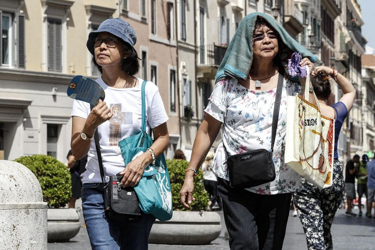 Tourists at the Spanish Steps during a hot day in Rome, Italy, on July 14, 2018.