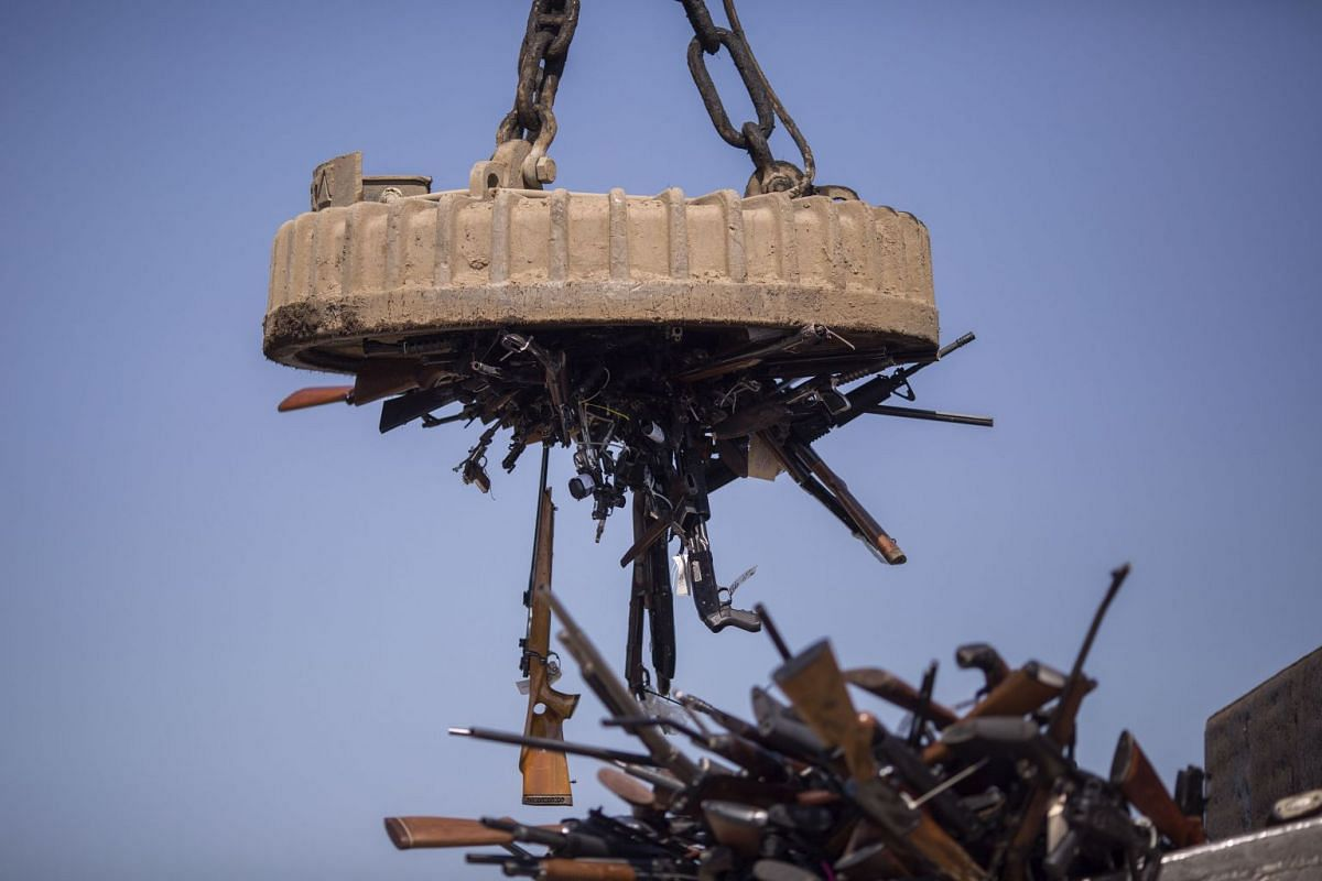 An electromagnet is used to pick up some of approximately 3,500 confiscated guns to be melted down at Gerdau Steel Mill on July 19, 2018 in Rancho Cucamonga, California. PHOTO: GETTY IMAGES/AFP