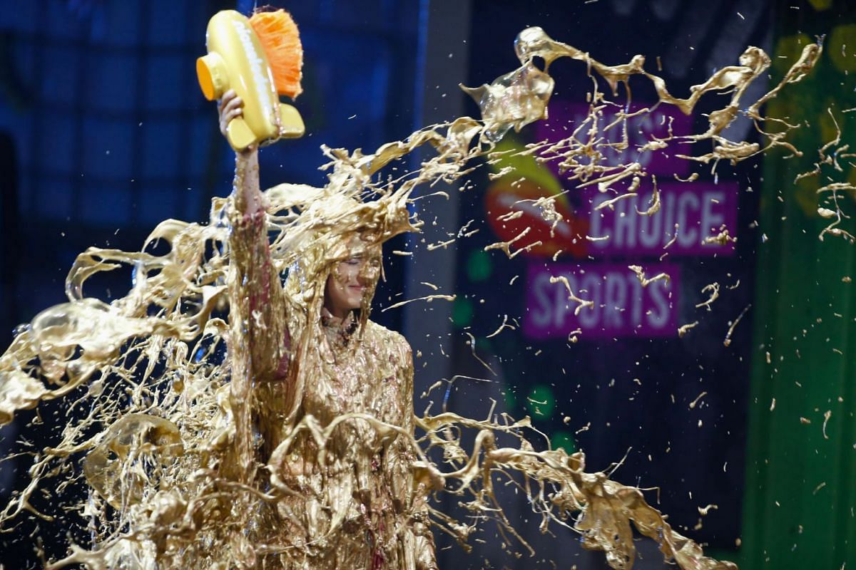 """Race car driver Danica Patrick gets """"slimed"""" as she accepts the Legend Award at the Kids Choice Sports Awards 2018  show in Los Angeles, California, U.S. on July 19, 2018. PHOTO: REUTERS"""