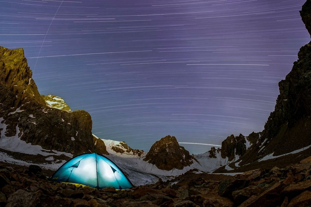 A long exposure picture shows stars and meteor trails above the mountains of Tien Shan, outside Almaty, Kazakhstan July 22, 2018.