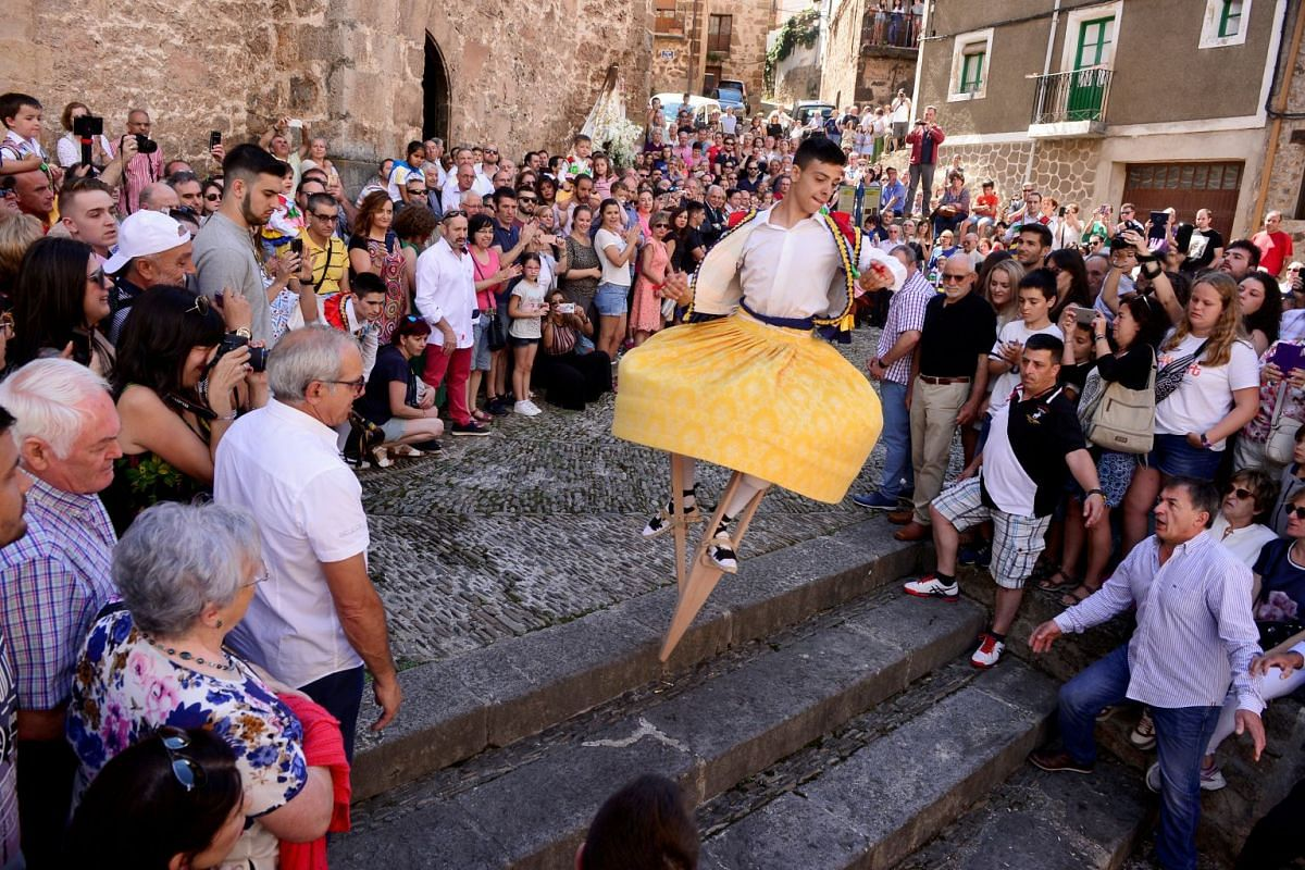 A skirt wearing dancer on stilts performs the whirling Dance of the Zancos on Saint Mary Magdalene's feast day in Anguiano, Spain, July 22, 2018.