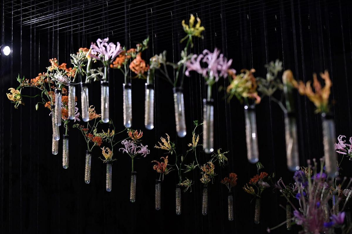 Test tubes decorated with cut flowers on the last day of setup for the floral window display at Gardens by the Bay, on July 19, 2018.