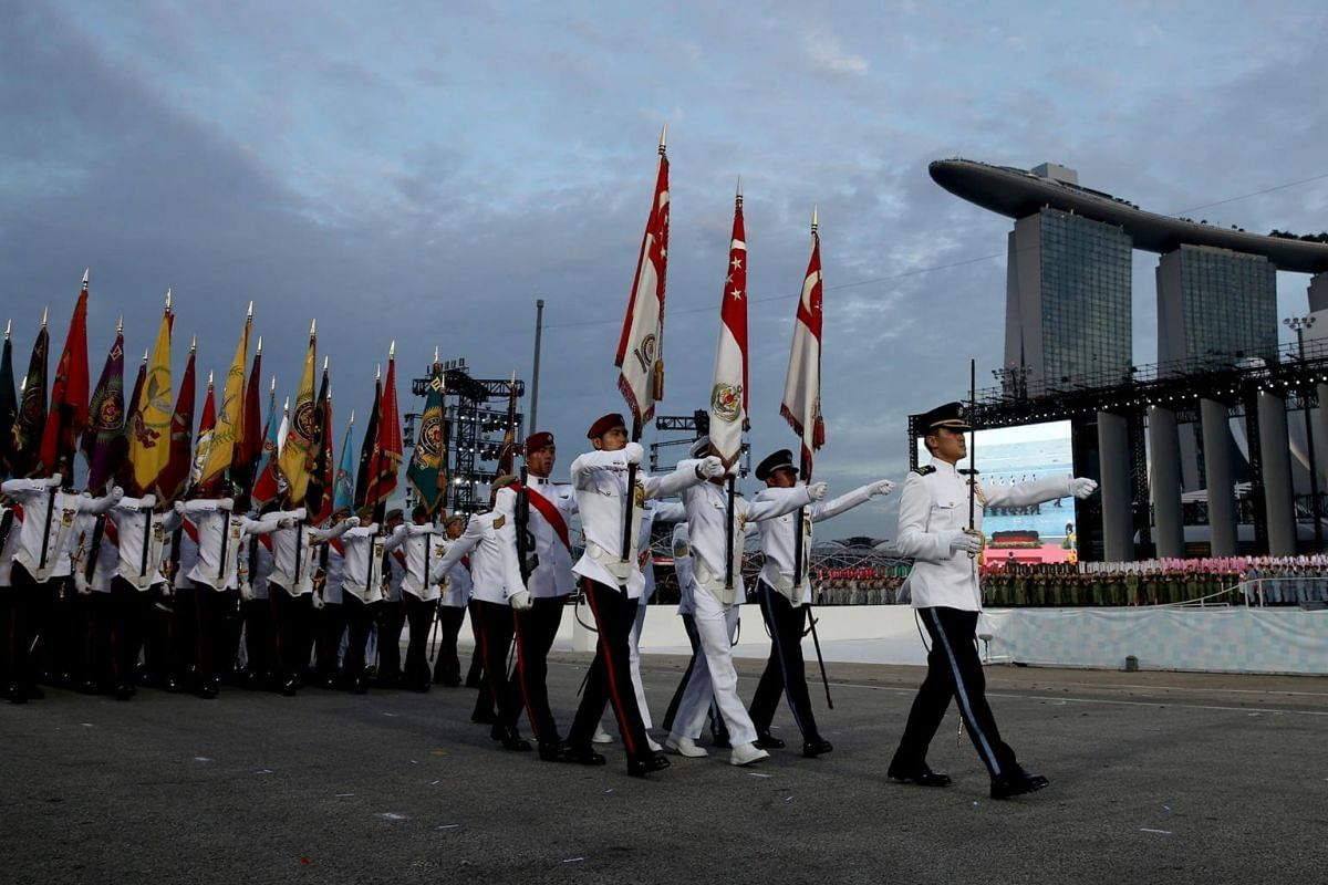The parade contingent made up of members from different uniformed groups marching past the spectator stand during the National Day Parade NE Show 3, on July 21, 2018.