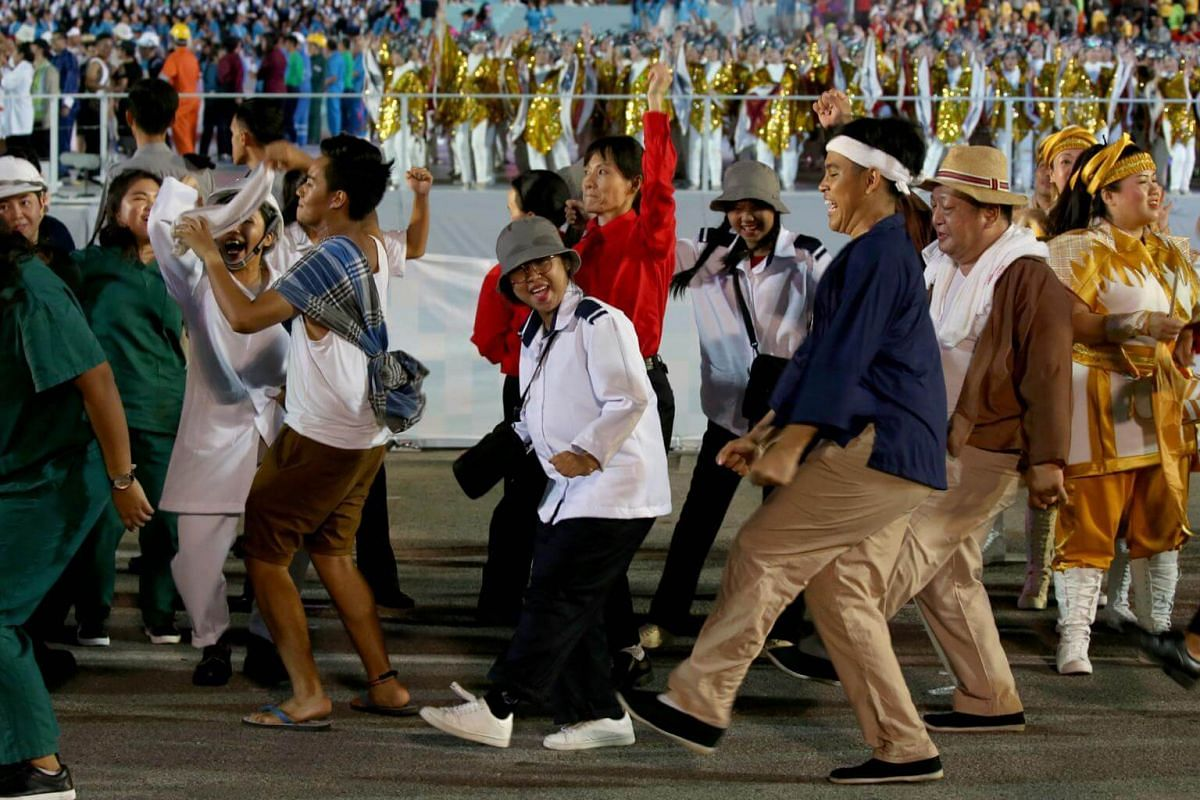 Performers celebrate and dance after the National Day Parade NE Show 3, on July 21, 2018.