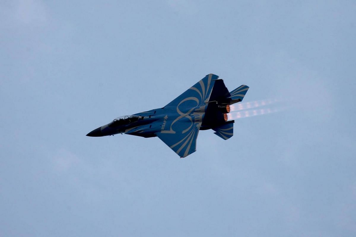 An F-15 jet, painted blue as part of the RSAF's 50th birthday later this year, excuting aerial movements during the National Day Parade NE Show 3, July 21, 2018.