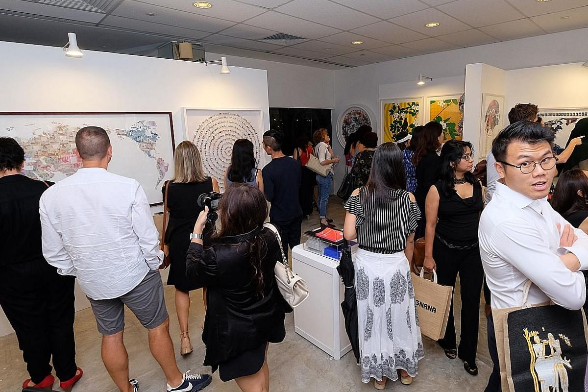 Visitors at the Affordable Art Fair, held at the F1 Pit Building last November. The annual fair returns this year, from Nov 16 to 18, at the same venue.