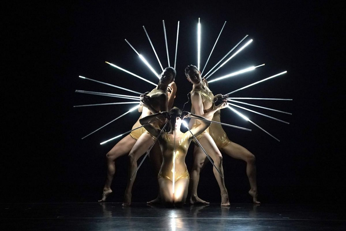 """Dancers with MOMIX performs a scene from """"Light Reigns (35th Anniversary Creation)"""" during a dress rehearsal before opening night at the Joyce Theater in New York July 24, 2018. MOMIX, the company of dance illusionists under the direction of Moses"""