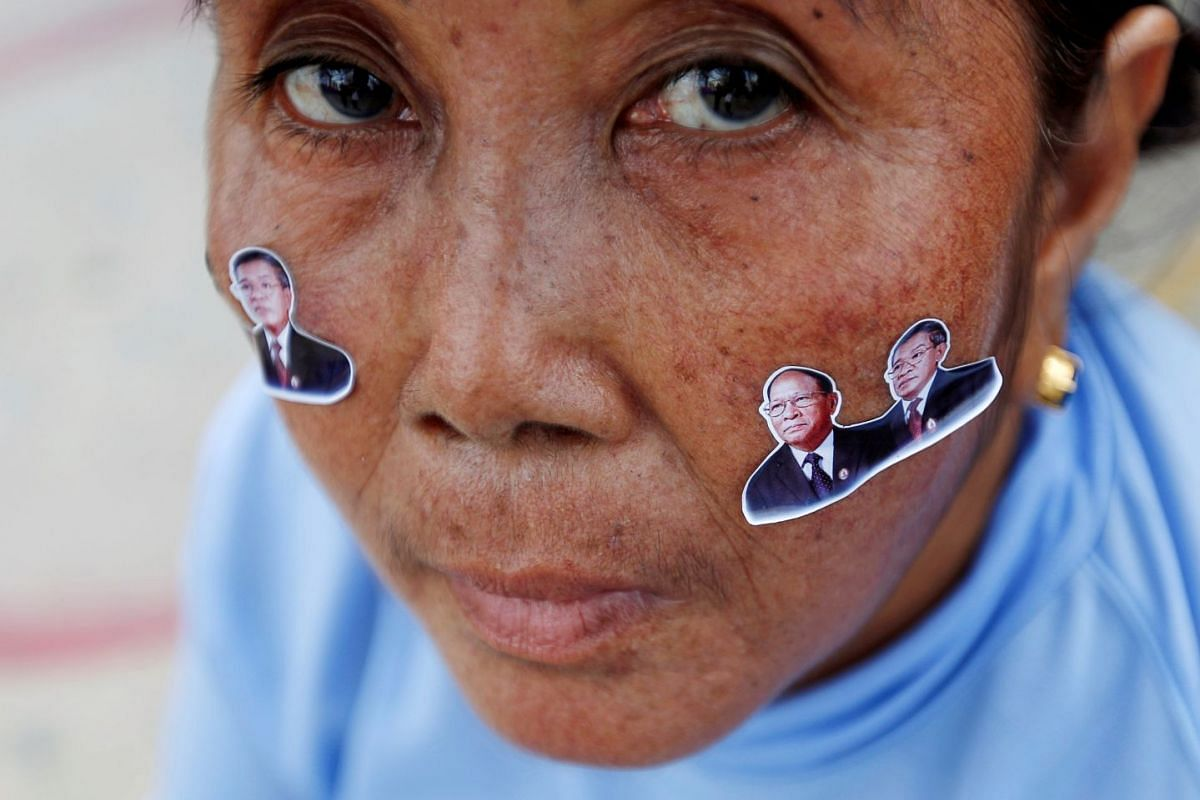 Stickers of President of the Cambodian People's Party (CPP) and Prime Minister Hun Sen and President of Cambodian National Assembly, Heng Samrin are seen on a supporter's face during campaign on final day in Phnom Penh, Cambodia, July 27, 2018.