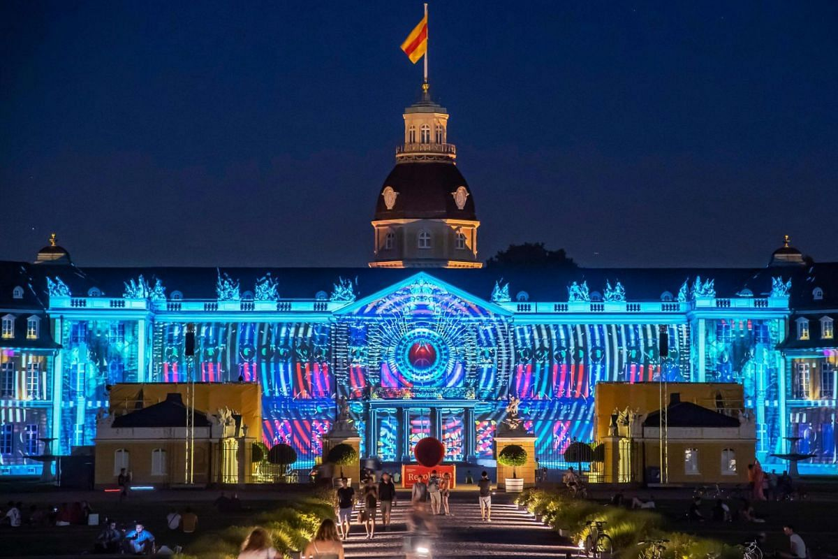 "The Karlsruhe Palace is illuminated during a rehearsal of the show ""The Object of The Mind"" created by the Global Illumination collective of visual artists and filmmakers, on July 26, 2018, two days ahead of the start of the Schlosslichtspiele light"