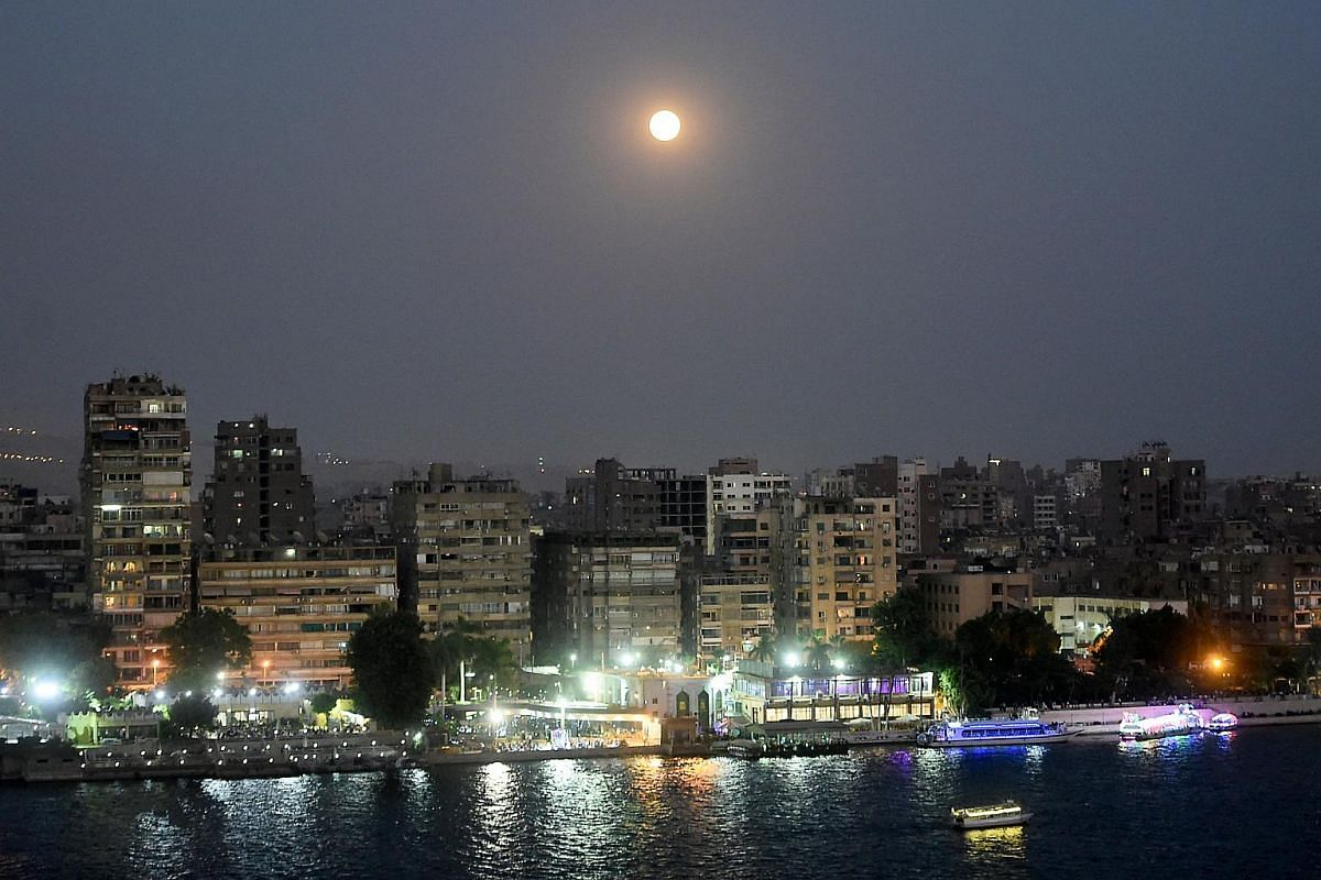 This picture shows the full moon in the sky of the Egyptian capital Cairo, on July 27, 2018, prior to the expected total lunar eclipse.