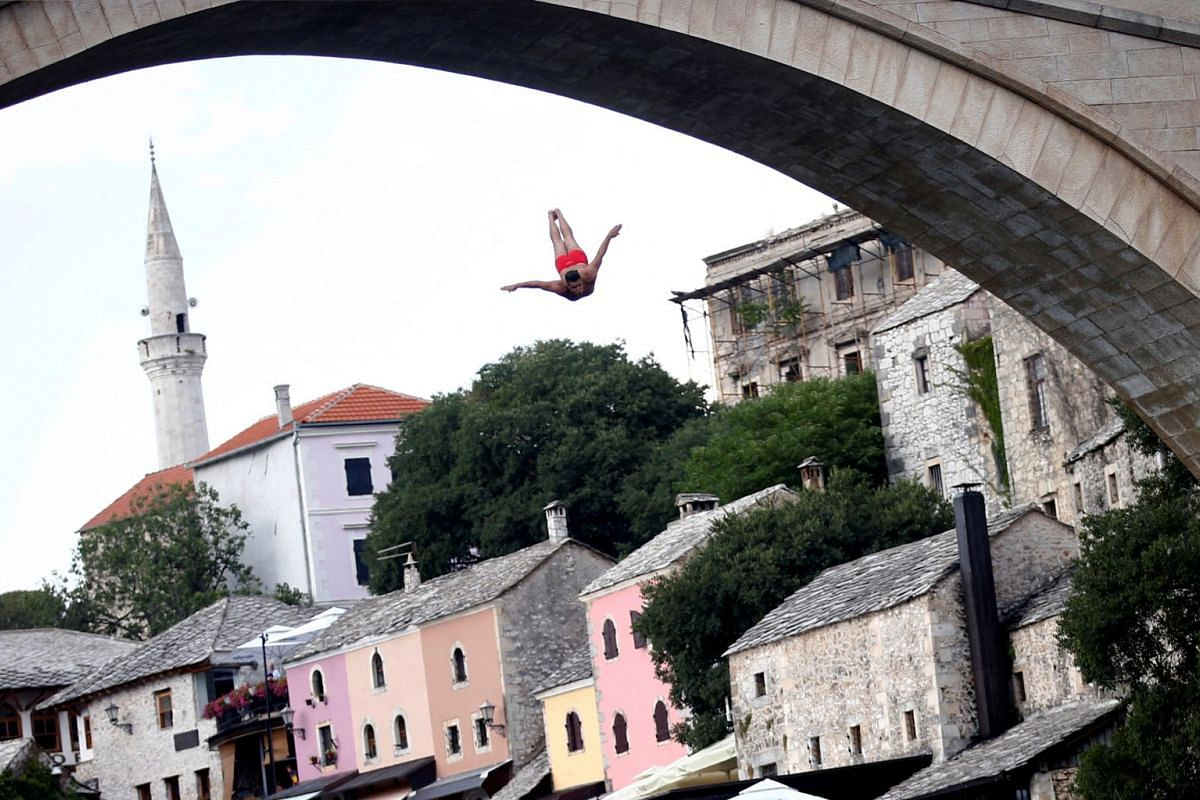 A man jumps from the Old Bridge during the 452nd traditional diving competition in Mostar, Bosnia and Herzegovina, July 29, 2018. PHOTO: REUTERS
