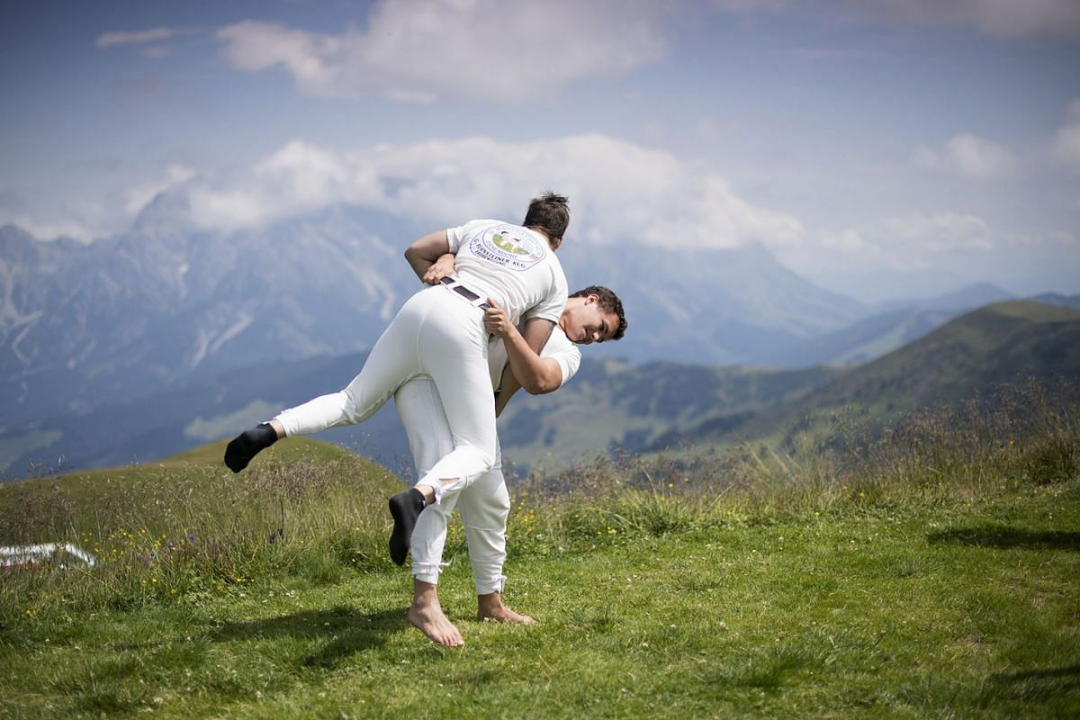 Competitors warm up prior to the Hundstoa Ranggeln on the 'Grosser Hundstein' mountain in Maria Alm Salzburg, Austria, 29 July 2018. The Hundstoa Ranggeln is a traditional sporting event in Salzburg. PHOTO: EPA-EFE