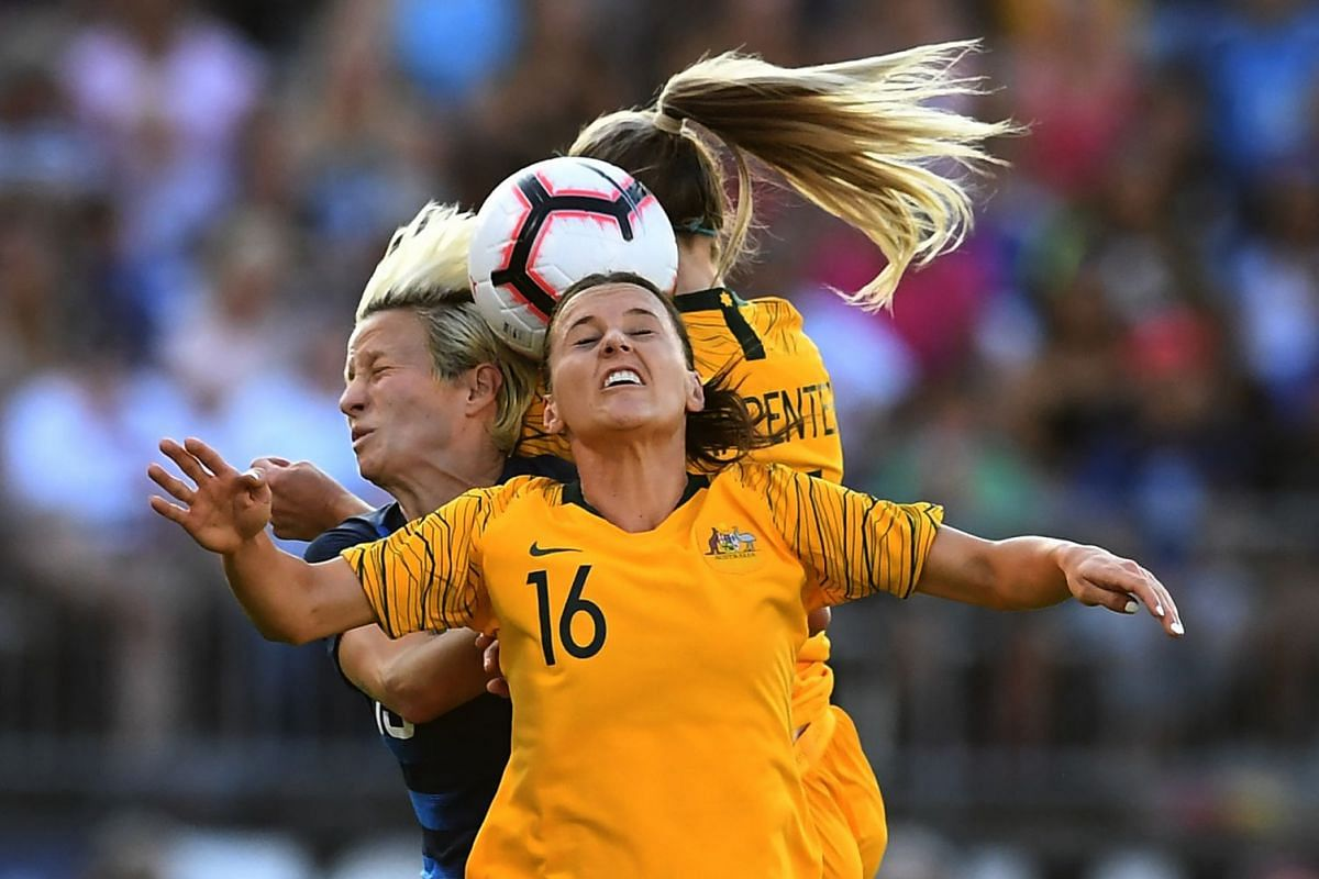 Australia's Hayley Raso heads the ball with USA's Megan Rapinoe during the 2018 Tournament of Nations at Pratt & Whitney Stadium at Rentschler Field on July 29, 2018 in East Hartford, Connecticut. PHOTO: AFP