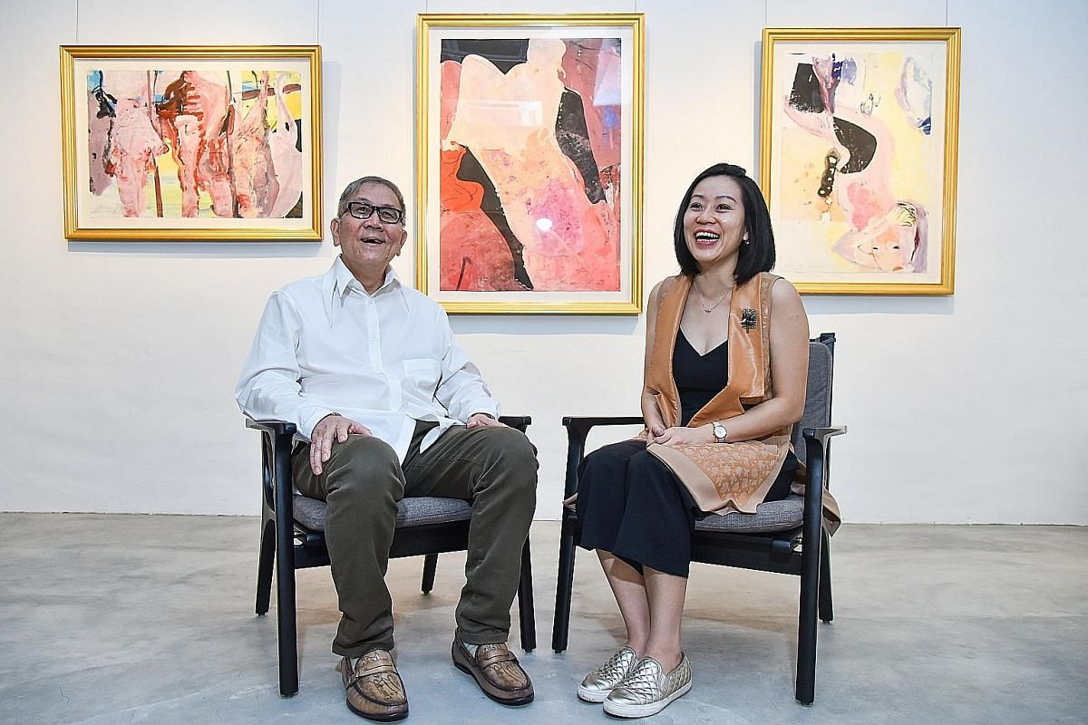 Mr Chong Huai Seng and his daughter Ning at their office in Thye Hong Centre, with works by local artist Wong Keen.