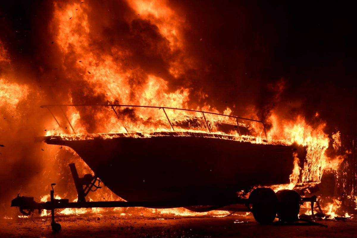 A boat burns as the fast-moving wildfire destroys homes and forces thousands of residents to evacuate in Goleta of California, US, on July 7, 2018.