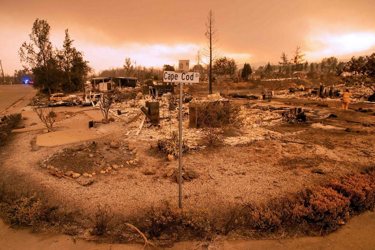 Ravaged properties near the Lake Keswick Estates area during the Carr Fire in Redding, California, on July 27, 2018. Two firefighters have died and more than 100 homes have been burned down.