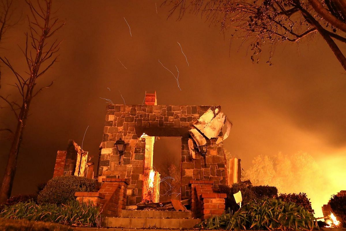 A home burning along Sunflower Road during the Carr Fire, which was reportedly only 6 percent contained.