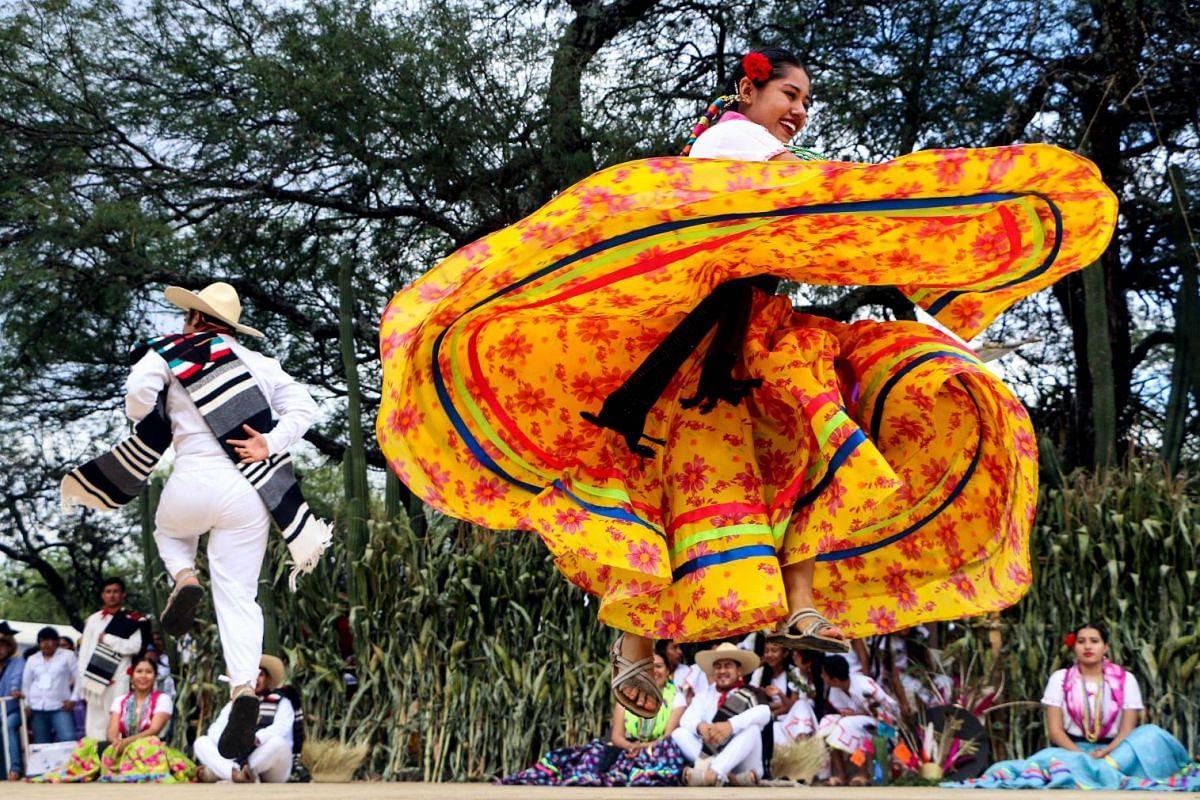 Regional dancers perform at the Guelaguetza festival on July 30, 2018 in Zaachila, Oaxaca, Mexico. PHOTO: AFP
